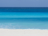 Shades of Blue Color the Beachfront Waters in Cancun  Mexico