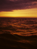 A Dramatic Sky Casts a Red Glow over Waves on Lake Michigan