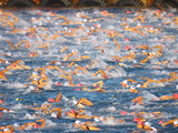 A Sea Full of Swimmers Competing in the Ironman Triathlon