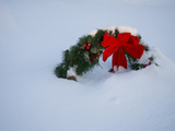 Bright Red Bow of a Cemetery Christmas Wreath Buried in Fresh Snow