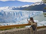 A Tourist Photographs the Perito Moreno Glacier in Argentina