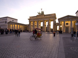 Tourists at the Brandenburg Gate at Twilight