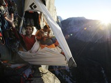 Climbers live in a portaledge when working on a route