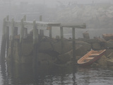 Rowboat in the Rocks and a Pier in Early Morning Fog