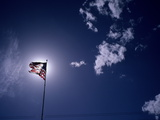 An American Flag Against a Glowing Sun