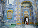 A Woman and Child Entering a Sufi Shrine in Sindh Province  Pakistan