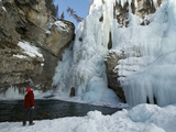 Boy Looking Up at the Frozen Upper Falls in Johnston Canyon