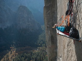 A Climber Reclines on a Hanging Camp on El Capitan