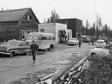 Locals Walk Down Muddy Main Street of Atomic Mineral Mining Town