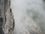 Climbers Ascend El Capitan Using Ropes