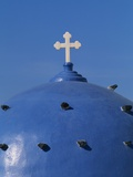 Blue dome of a church with cross on Santorin  Greece