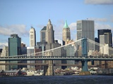 Skyline of New York City with East River  Manhattan and Brooklyn Bridge