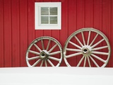 Wagon Wheels on Snow Against Stable