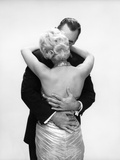 1950s 1960s Wife In Backless Satin Gown Evening Dress And Husband Embracing And Kissing