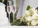 Wedding bouquet and champagne glasses