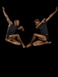 Two male dancers jumping