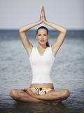 Woman meditating in the ocean