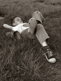 1960s Boy Sleeping In Grass Legs Crossed Holes In Sneakers Baseball Mitt By His Side