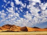 Dunes in Namib Desert Under White Clouds