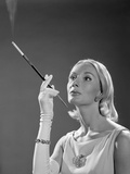 1960s Elegant Woman Wearing Gown With French Cigarette Holder