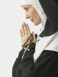 Praying Nun Holding Rosary