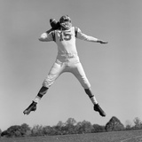 1960s Quarterback Jumping And Throwing Pass Football