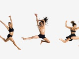 Three dancers jumping
