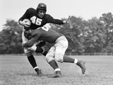 1940s Football Player Being Tackled