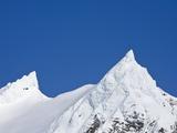 Snowy Peaks in Blue Sky