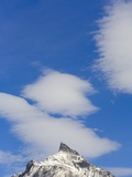 Clouds and Snowy Mountain Peak