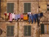 Laundry Hanging Outside Windows