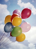 Bunch Of Multicolored Balloons In Blue Sky With White Clouds