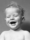 1940s Portrait Baby With Messy Hair Laughing With Eyes Closed