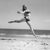 1950S Woman in Bikini Running and Jumping on the Beach Smiling