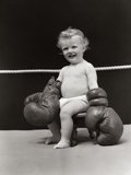 1930s Baby Seated On Stool In Boxing Ring Wearing Oversized Boxing Gloves Wearing Diaper