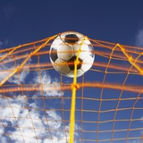 Soccer Ball Going Into Goal Net