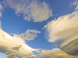 Cumulus and Lenticular Clouds at Sunrise