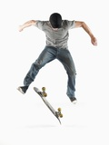 Young Skateboarder Doing Trick