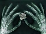 Skeletal Hands Holding Barcode