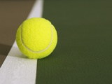 Tennis ball on white boundary stripe