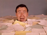 1960s Overwhelmed Screaming Bug-Eyed Man Drowning In Paper Work