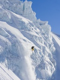 Skier going over edge of cliff