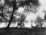 1890s 1900 Older Brother Watching Three Younger Children In Rowboat On Small Lake