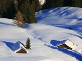 Cabins Nearly Covered in Snow in the German Alps