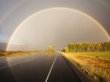 Double rainbow on country road in autumn