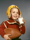 1950s 1960s Boy Drinking Glass Milk Wearing Football Helmet Shoulder Pads