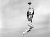 1970s Player Jumping To Catch Football Pass