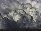 Heavy cumulus clouds above sagebrush desert
