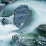Rushing water and rocks on South Island  New Zealand