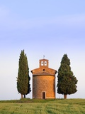 Chapel and cypress trees